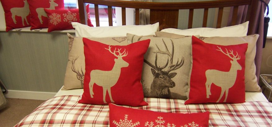 Red is the colour in Christmas cushions and decor