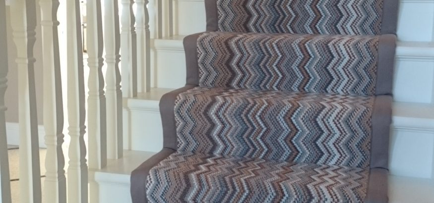 Stair runner with woven border