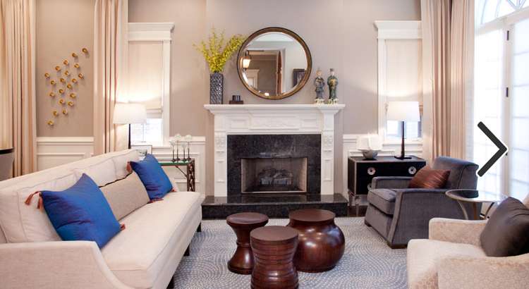 Circular Mirror over fireplace