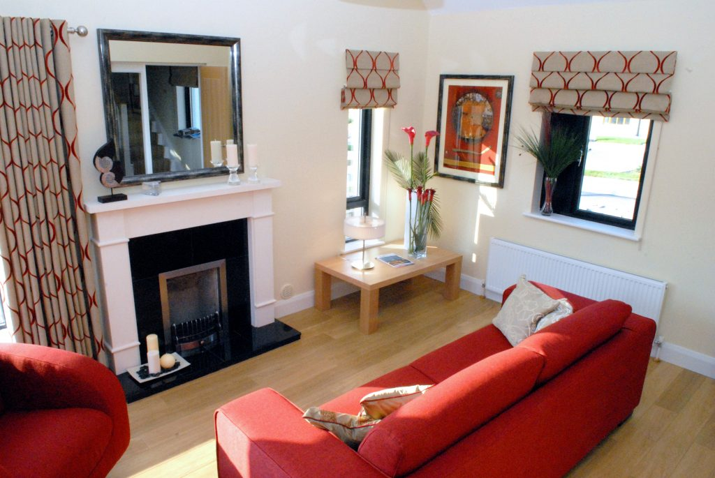 Colourful sofa in situ medium sized sitting room